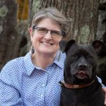 Lisabeth Wotherspoon with her dog, Onyx, trauma therapist near Dover, NH.